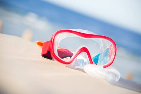 Snorkeling mask and tube on tropical beach