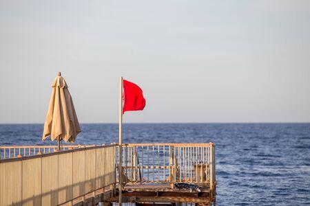 Red flag warning sign no swimming Stock fotó