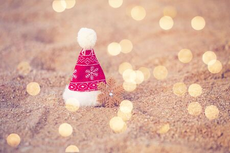 Santa hat on the beach sand