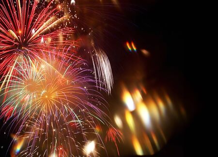 Abstrakter Feuerwerkshintergrund des neuen Jahres Standard-Bild