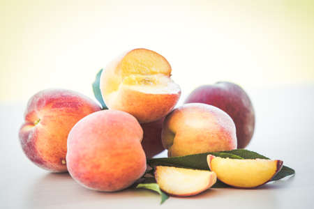 Organic cultured ripe peach fruits