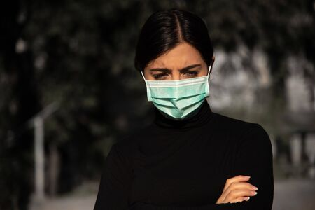 frustrated woman with protective fase mask - covid-19 - corona crisis concept picture Stock fotó