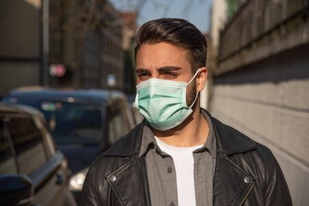 man with protective fase mask - covid-19 -  corona crisis concept picture Stock fotó