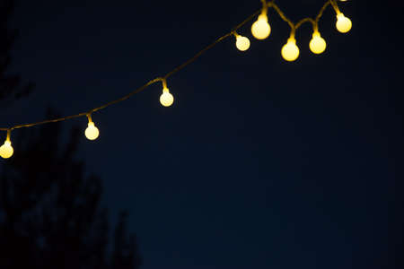 Chain of lights brings light into the dark night - a cozy atmosphere