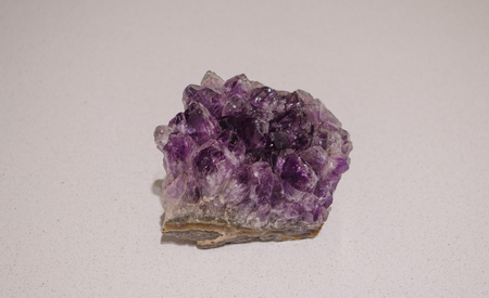 Beautiful and purple amethyst gemstone closeup. Positive energy stone to harmonize body and mind.