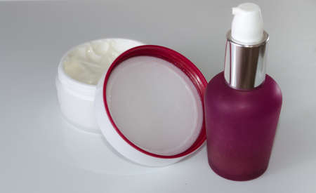 Selective focus of beauty cosmetic products on white background. Lotion and cream for woman wellness and care.