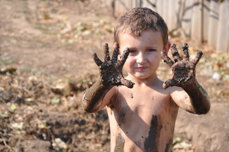 disobedient: child and mud