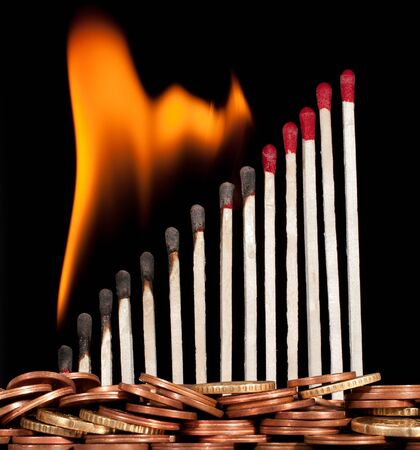 graph of the burning matches against money photo