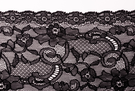 Black lace on a white background photo