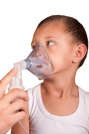 little boy in the mask of the inhaler photo