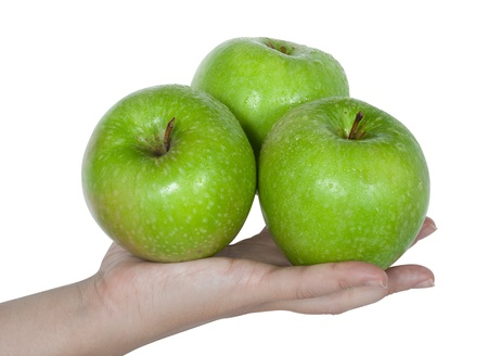 three green apples on the female hand isolated photo