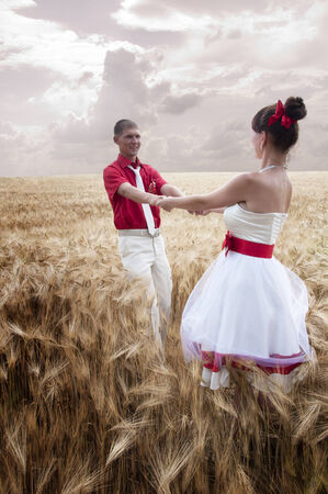 newlyweds go on the field holding hands photo