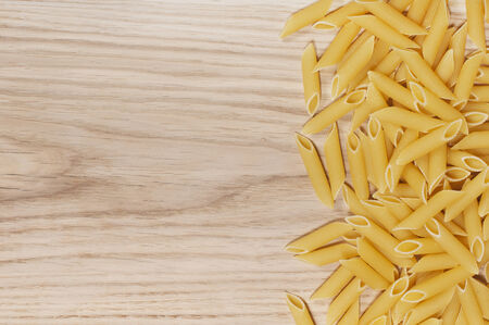 scatters: Italian pasta scattered on a cutting board