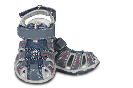 children s feet: sandals for kids on a white background