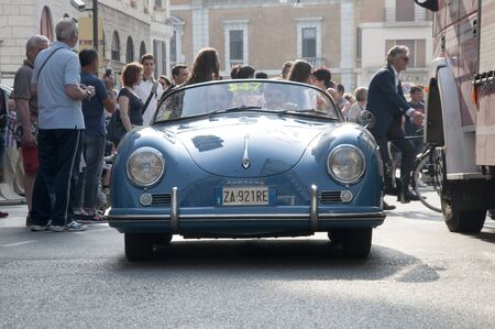rugger: BRESCIA,ITALY - MAY,13:Registration of participants of the famous race retro cars Mille Miglia, May 13,2015 in Brescia,Italy.Driver Andrea Rugger on PORSCHE 356 1500 Speedster, 1955 built Editorial