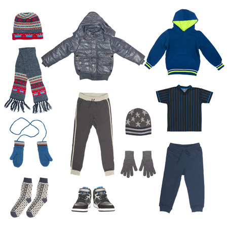 winter people: set of child winter clothing isolated on white