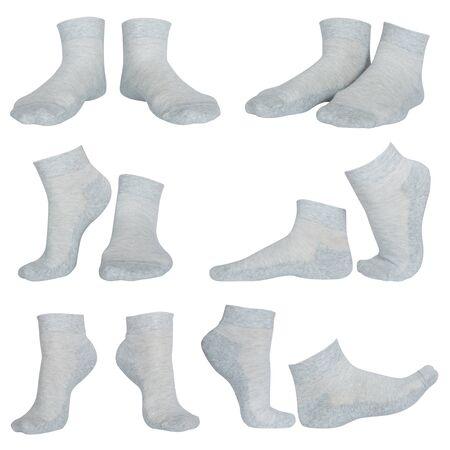 calcetines: calcetines grises femeninos aislados en blanco Foto de archivo