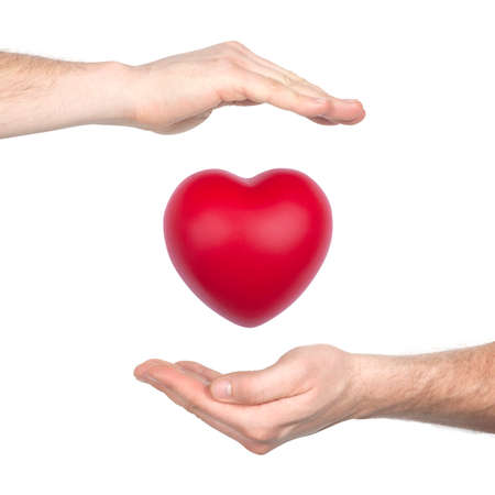 cherish: male hands holding red heart isolated on white