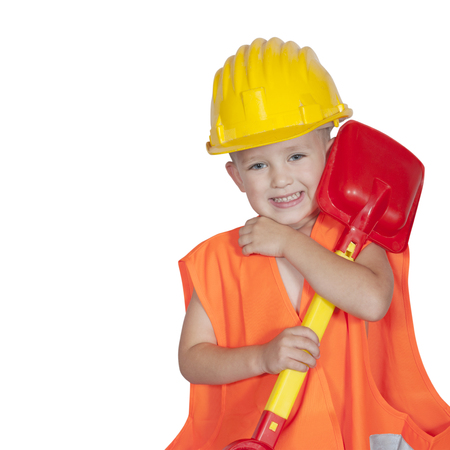 boy with a shovel in a protective helmet and orange vest Stock Photo