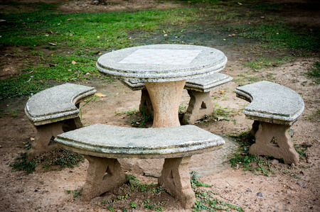 disorderly: old stone table and stool in the garden.