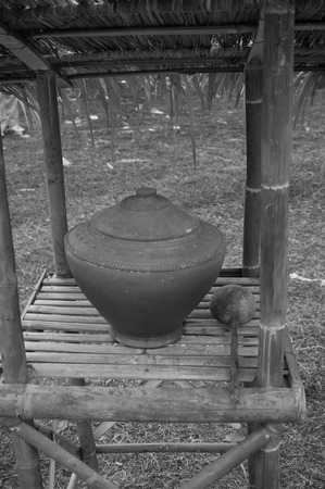 clay pot and dipper in the garden. photo