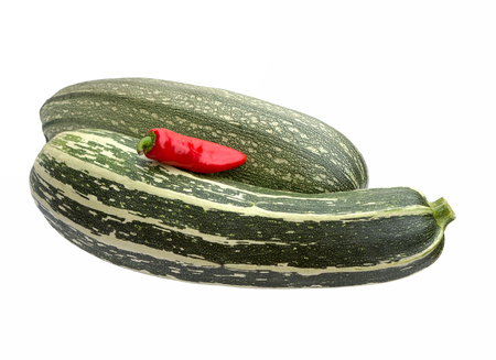 medula: Vegetable marrow (zucchini) and red pepper isolated on white background