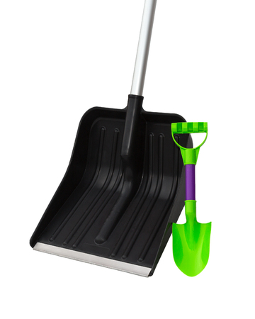 Shovel for snow and a childrens toy a spade.