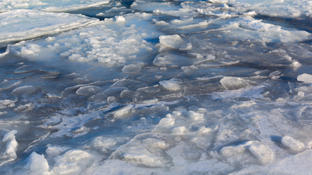 Frozen ice shoreline over the sea. Ice formations at the coast Sea of Japan. Drift ice.