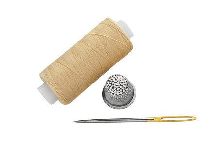 Sewing Threads spool with sewing Needle and Thimble isolated on white background Stock Photo