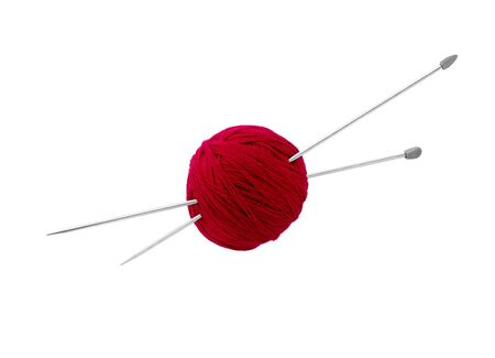 Balls of red wool yarn and knitting needles isolated on white background.