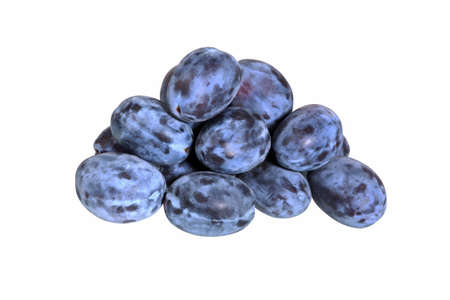 Plums isolated on White Background. Juicy prunes plum heap close up.