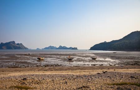 ebb: Ebb and small boats at Cat Ba island in Ha Long bay, Vietnam