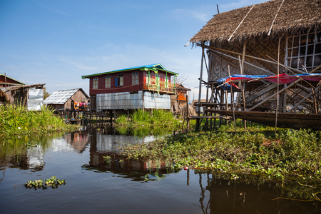 house float on water: Houses and floating gardens at one of Inle Lake villages on the water in Myanmar. Stock Photo