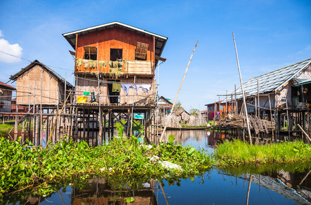 inle: Houses and floating gardens at one of Inle Lake villages on the water in Myanmar. Stock Photo