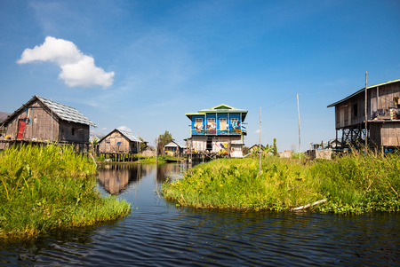 pile dwelling: Houses and floating gardens at one of Inle Lake villages on the water in Myanmar. Stock Photo