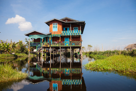 lake dwelling: House and floating gardens at one of Inle Lake villages on the water in Myanmar. Stock Photo