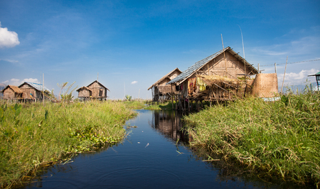lake dwelling: Houses and floating gardens at one of Inle Lake villages on the water in Myanmar. Stock Photo