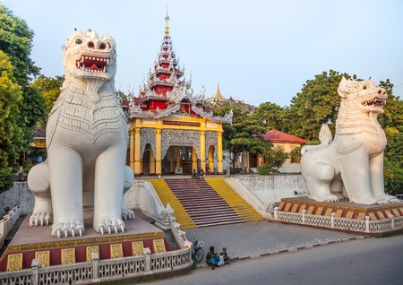 tourist site: Mandalay, Myanmar-12 December, 2015. Southern stairway with its magnificent guardian chinthe at the entry to Mandalay hill pagodas on 12 December, 2015 in Mandalay.