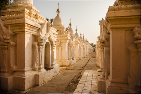 Shrines of the Worlds Largest Book at Kuthodaw Pagoda at sunrise in Mandalay, Myanmar