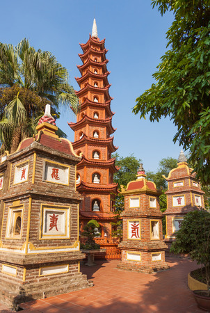 Vietnam. Pagoda of Tran Quoc temple in Hanoi and is the oldest pagoda in the city. The pagoda are red because in Chinese and Vietnamese culture red symbolizes luck and prosperity. Фото со стока