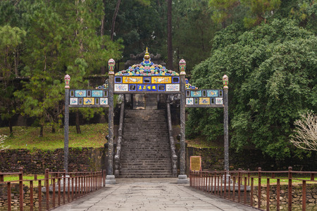 Vietnam, Hue. Bridge, gates and steps to the burial area, where is underground palace with coffin of Minh Mang Emperor, surrounded by wall at Imperial Minh Mang Tomb complex. Redakční