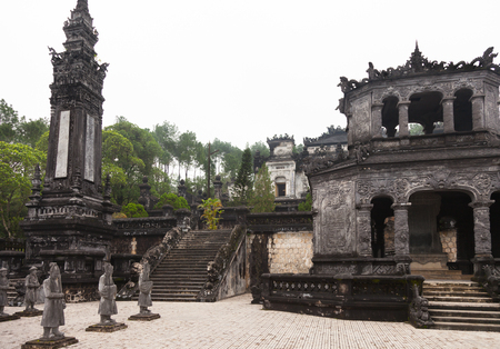 Hue, Vietnam. Royal Khai Dinh Tomb complex from salutation court with Emperors honor guard, Stele House, one of two Obelisks and stairs leading to the Thien Dinh Palace where Khai Dinh Emperor is buried.