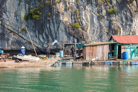 Ha Long Bay, Vietnam-December 20, 2013. Vietnamese fishermen in their daily life environment at Floating Fishing Village on December 20, 2013 in Ha Long Bay of northeast Vietnam. Editorial