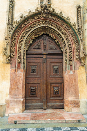 Prague, Czech Republic. Late Gothic door in the house adjacent to the tower serves as the main entrance to the Old Town Hall.