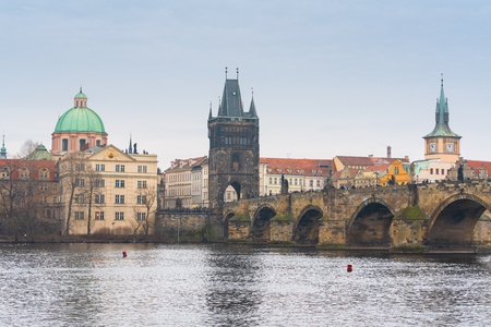 Prague, Czech republic. Famous historical Charles bridge with old town tower that crosses the Vltava river in old town.