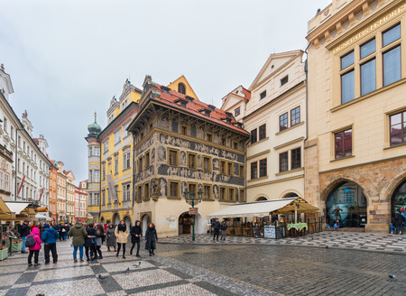 Prague, Czech Republic-February 2, 2019. The House at the Minute, Kafka family home which facade, decorated with sgraffito, depicts scenes drawn from biblical and mythological sources, as well as cont