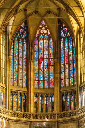 Prague, Czech Republic. Stained-glass windows at main nave of the St. Vitus Cathedral, part of the Prague Castle complex. The frescoes (14th-16th centuries) depict scenes from the passion of Christ.