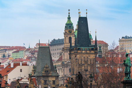 Prague, Czech Republic. Tops of the buildings and the Mala Strana Bridge Towers of the Charles bridge.