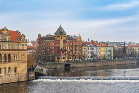 Czech Republic. Buildings right next to Charles Bridge on the right bank of the Vltava river in the historical Old Town of Prague.