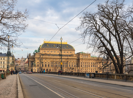 Prague, Czech Republic-January 31, 2019. View of the road of the Legions Bridge and old town buildings with Prague National Theatre on January 31, 2019.